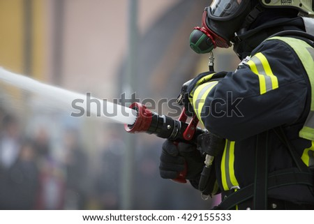 Wasserburg, South Germany - May 25, 2016: Fire Brigade Services Training in front of the public in a small town in south Germany.
