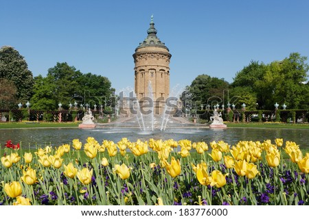 Wasserturm in Mannheim, Germany. Wasserturm (water tower) is Mannheim's local landmark, erected 1886 to 1889. It is surrounded by a public park and garden, a popular spot for locals and tourists.  - stock photo