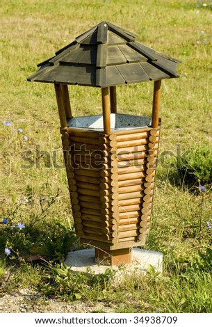 waste bin of wood in a park - stock photo