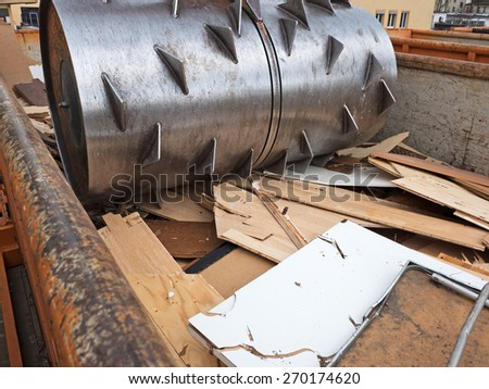 waste compactor in action in a container - stock photo