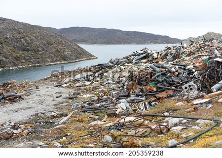 Waste disposal site in Aasiaat, Greenland with old pipes - stock photo