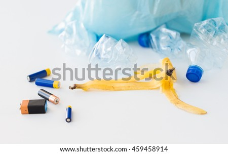 waste recycling, reuse, garbage disposal, environment and ecology concept - close up of rubbish bag with trash or garbage - stock photo