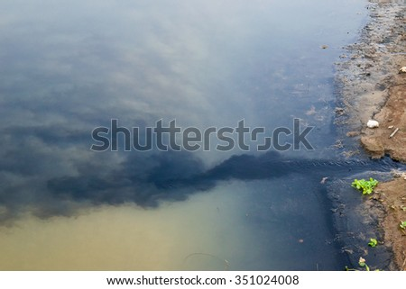 waste water (black water)  flows into the river - stock photo
