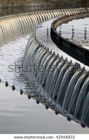 waste water clarifier waterfalls - stock photo