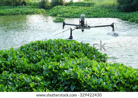 Waste water treatment by aerator - stock photo