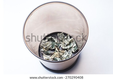 Wasted Money In Waste Basket - stock photo