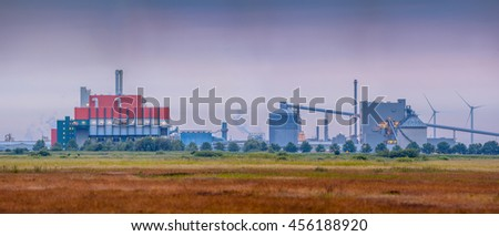 Wasteland to be developed with Chemical Industry in background - stock photo