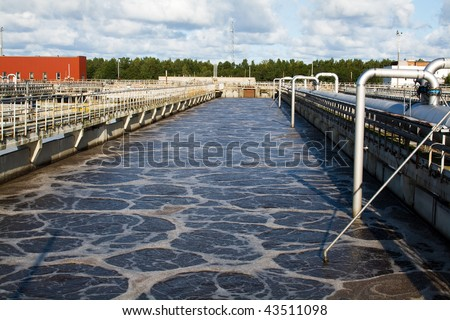 Wastewater aeration basin bubbling - stock photo