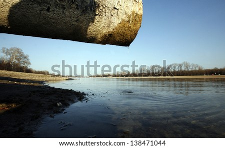 wastewater into the lake - stock photo
