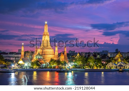 Wat Arun along Chao Phraya River during sunset in Bangkok, Thailand - stock photo