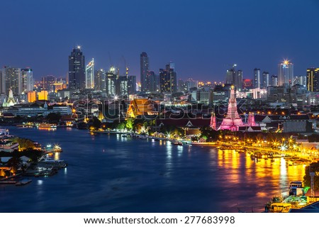 Wat Arun along the Chao Phraya river at dusk (Bangkok, Thailand) - stock photo