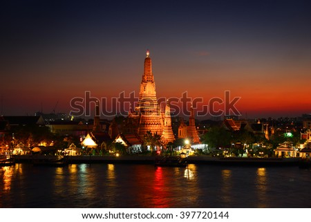 Wat Arun at twilight time. Buddhist temple located along the Chao Phraya river in Bangkok, Thailand  - stock photo