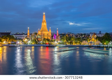 Wat Arun Buddhist religious places in twilight time, Bangkok, Thailand - stock photo