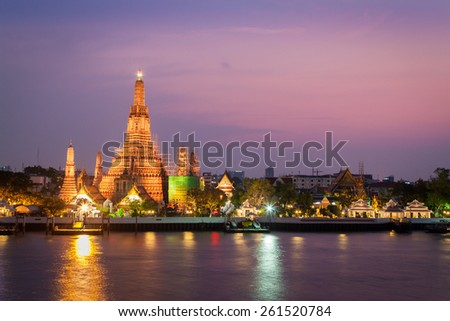 Wat Arun or the temple of the dawn, Famous thai temple located next to the river during sunset - stock photo