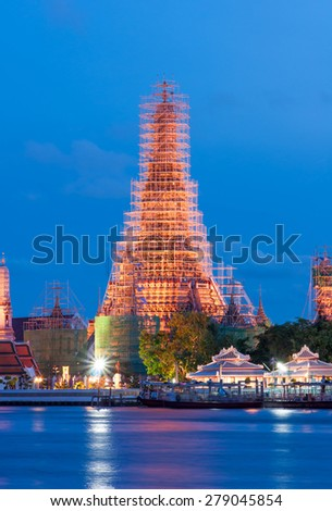Wat Arun Temple during repair in sunset at bangkok thailand - stock photo