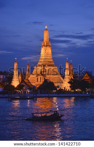 Wat Arun, The Temple of Dawn, at twilight, view across Chao Phraya river. Bangkok, Thailand - stock photo