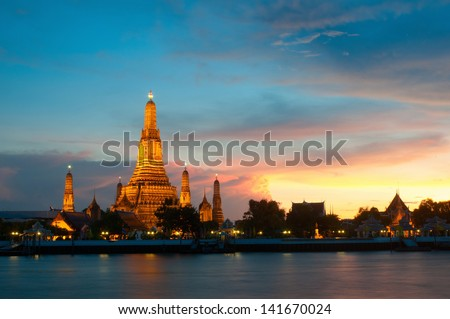 Wat Arun the Temple of Dawn during sun set on Chaophraya River Bangkok Thailand. - stock photo