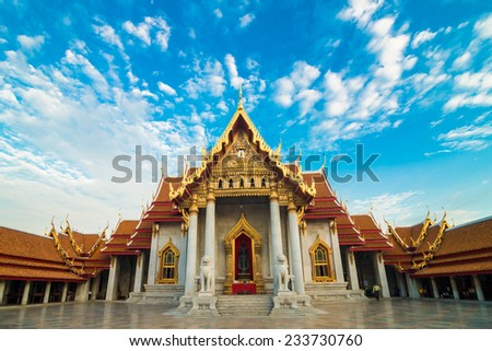 Wat Benchamabophit or Marble temple on blue sky white cloud in Bangkok, Thailand - stock photo