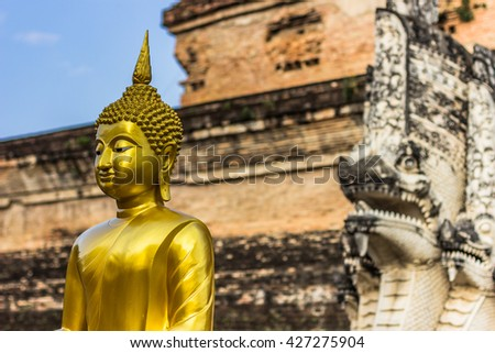 Wat Chedi Luang temple in Chiang Mai, Thailand (Delierate high contrast in sky and slight low exposure for dramaric effect) - stock photo