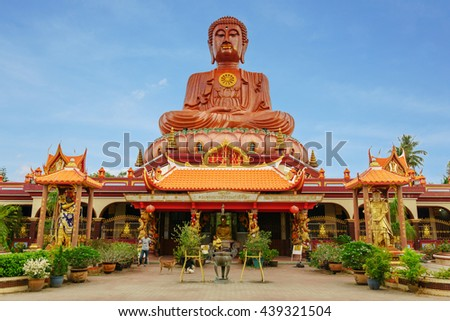 Wat Machimmaram (Temple of Sitting Budha) in Tumpat Kelantan, Malaysia. This temple houses the largest sitting Buddha statue in Southeast Asia - stock photo