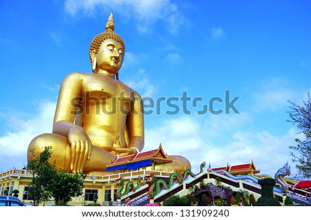 Wat Muang / The largest Buddha statue in Thailand is located at Wat Muang in Angtong. Surrounded by picturesque rice fields, it rises out of the countryside - stock photo