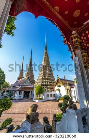 Wat pho is the beautiful temple in Bangkok, Thailand. The official name being Wat Phra Chetuphon Vimolmangklararm Rajaworamahavihara. - stock photo