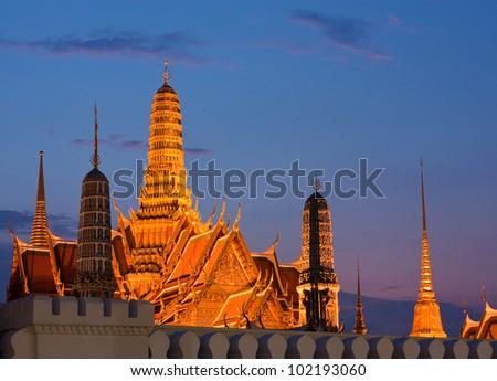 Wat Phra Kaew,  Grand Palace of Thailand in twilight - stock photo