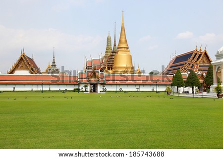 Wat Phra Kaew Temple of the Emerald Buddha and the home of the Thai King. Wat Phra Kaew is one of Bangkok's most famous tourist sites and it was built in 1782 at Bangkok, Thailand. - stock photo