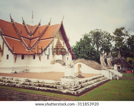 Wat Phumin at Nan province Thailand with retro filter effect - stock photo