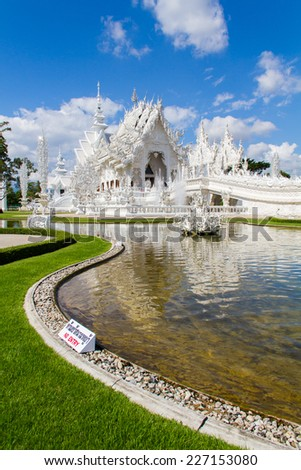 Wat Rong Khun Buddhist temple with white. In Chiang Rai, Thailand - stock photo