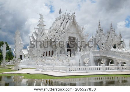 Wat Rong Khun one of the famous temple in Chiang rai, Thailand. - stock photo