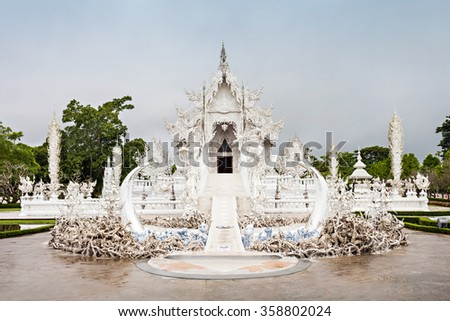Wat Rong Khun (White Temple) is a contemporary art exhibit in the style of a Buddhist temple in Chiang Rai, Thailand  - stock photo