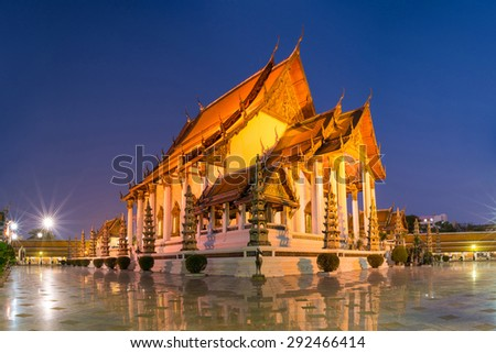 Wat Suthat Thep Wararam temple during twilight time in Bangkok Thailand  - stock photo