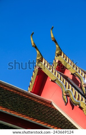 Wat Thai roof ornament with blue sky it decorate by stained glass - stock photo