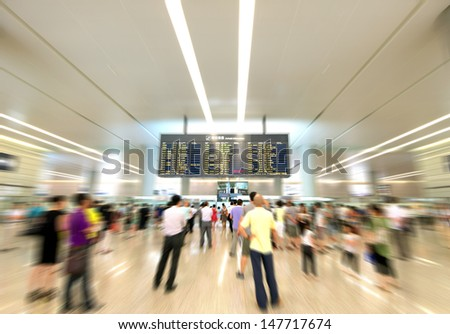 Watch airport arrival information for passengers, Motion Blur. - stock photo