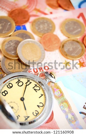 Watch and coins for euro. - stock photo