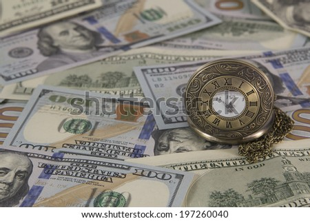 Watch and money - stock photo