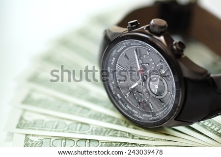 Watch and money concept for business investment or time is money - stock photo