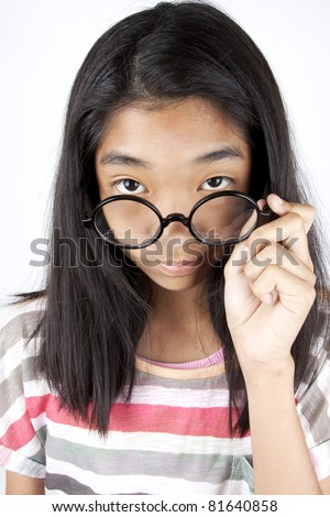 watch, Asian kid do watching eyeshot with glasses on. - stock photo