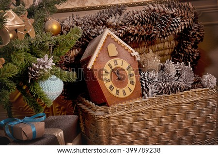 Watch Christmas in a basket with pine cones - stock photo