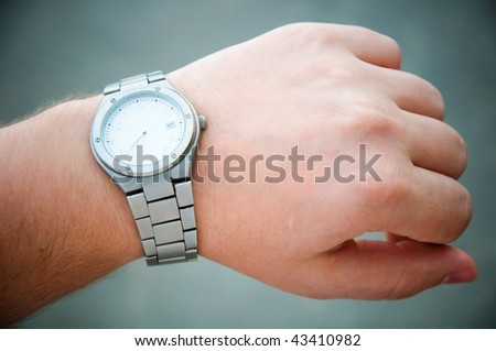 watch on a hand - stock photo