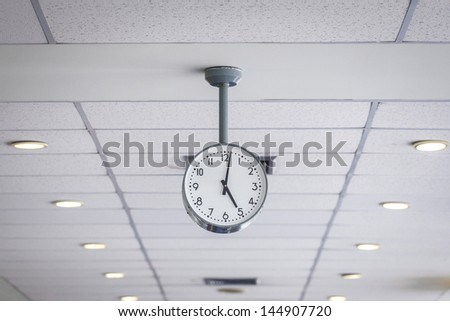 Watch on ceiling - stock photo