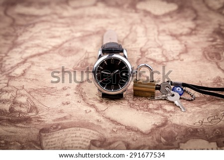 Watch on map background, the lock with a key on world Map - stock photo