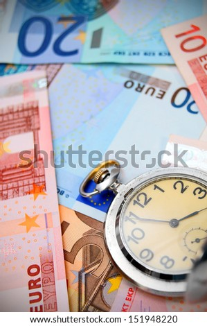 Watch on the euro banknotes. - stock photo