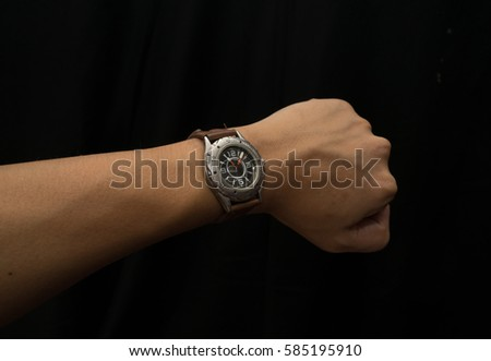 Watch on wrist isolated over a black background