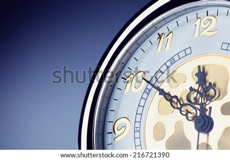 Watch over blue background, close-up - stock photo