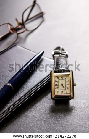 watch, pen and glasses on table, close up photo - stock photo