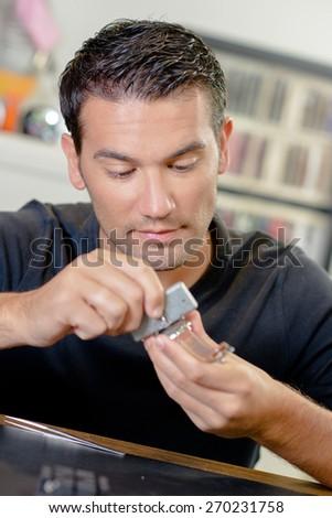 Watch repair man - stock photo