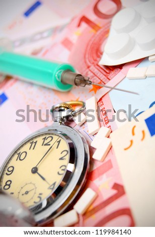Watch, tablets and a syringe for euro banknotes. - stock photo
