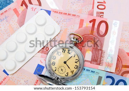 Watch, tablets  for euro banknotes - stock photo